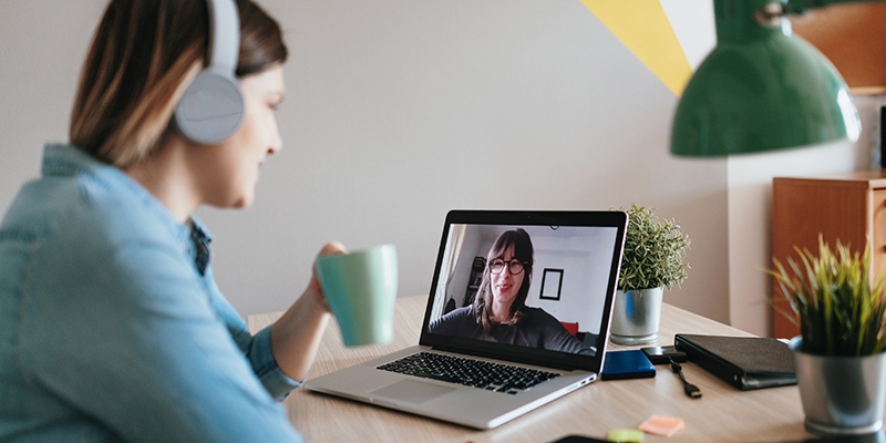 Woman Virtually Managing a Family Law Firm on Video Call with Woman | AmicusAttorney